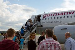 Boarding. Tourists are boarding a german wings plane at stuttgart airport Stock Image