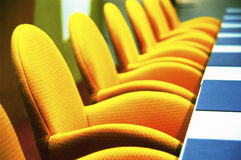 Boardroom. Interior of modern boardroom with yellow chairs and funky retro d�cor Stock Photo