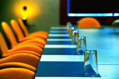 Boardroom. Interior of modern boardroom with yellow chairs and funky retro d�cor Stock Image