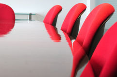 Boardroom. With red seats in a row Royalty Free Stock Photos