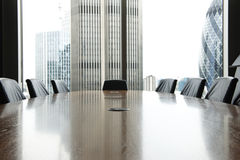 Boardroom. View of boardroom table with chairs and city buildings in background