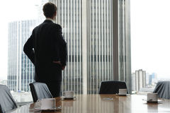 Boardroom. Single adult business man waiting for meeting to begin in Board room Stock Image