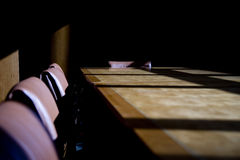 Boardroom. Darkened boardroom with heavy shadows, cold and uninviting and empty seats royalty free stock photos