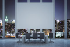 Boardroom with billboard at night Royalty Free Stock Photos
