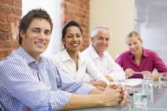 boardroom businesspeople four smiling Στοκ εικόνα με δικαίωμα ελεύθερης χρήσης