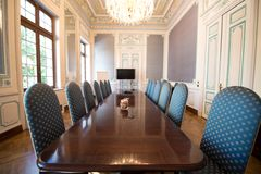 Boardroom with comfortable chairs. Empty boardroom ready for business meeting with comfortable chairs and luxury cherry wood conference table Stock Photos
