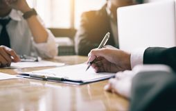 Boardroom with human resource business people writing paper negotiating a contract. royalty free stock photo