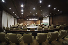 Boardroom with round table and armchairs around it Stock Photos