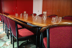 Boardroom table and chairs royalty free stock photos