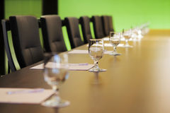The boardroom table is set for a meeting Stock Image
