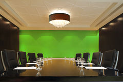 The boardroom table is set for a meeting Royalty Free Stock Photo