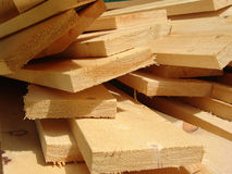 Boards 2. Wooden boards laying on grass on a construction site Stock Images