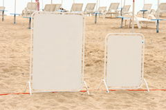 Boards on the beach. Blank white boards on the beach Royalty Free Stock Image