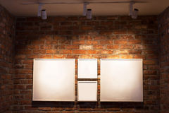 Boards in frames on brick wall Stock Photography