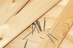 Boards and nails. Metal nails and wooden boards, during construction work. Photo taken in close-up Royalty Free Stock Photos