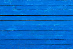 Boards painted in blue color. Background of rough planks painted in blue color Stock Images