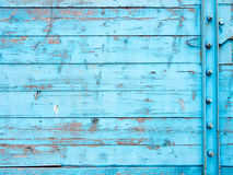 Boards painted with blue paint. Bonded metal bolts Royalty Free Stock Image