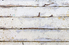 Boards with peeling old paint. Texture in the form of boards, in which the old paint peeled off in places Royalty Free Stock Photos