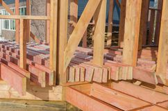Construction of wooden frame house. Boards processed by fire-biological protection for construction, in a wooden house frame Stock Images
