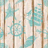 Boards of ship deck seamless pattern. Old boards of ship deck seamless pattern painted by anchor, wheel, seashell, starfish and sailboat print Royalty Free Stock Photography