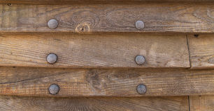 Boards stacked knocked fixed metal rivets nails frosted aboard merchant ships Royalty Free Stock Images