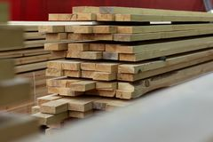 Boards stacked in a pile are dried in the open air. Storage and drying of boards according to the technology stock images