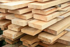 Boards in stacks outside Royalty Free Stock Images