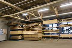 Boards storing at woodworking factory warehouse. Production, manufacture and woodworking industry concept - boards storing at factory warehouse royalty free stock photo