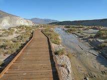 Boardwalk. Wooden boardwalk along small seasonal creek in Death Valley national park in California, Salt Creek trail Royalty Free Stock Photos