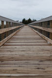 Boardwalk along the Bay. A boardwalk along the bay; vertical ocean Royalty Free Stock Photos