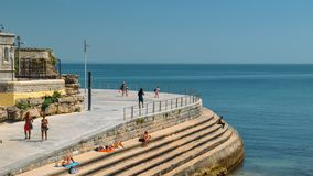 Boardwalk along Duquesa Beach in Cascais, Portugal during a sunny summer day. Cascais, Portugal - August 30th, 2018: Boardwalk along Duquesa Beach in Cascais stock images