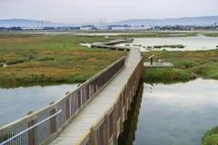 Boardwalk through Alviso Marsh on a cloudy day. San Jose, South San Francisco Bay, California Royalty Free Stock Photos