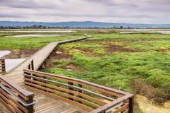 Boardwalk through Alviso Marsh on a cloudy day, San Jose, South San Francisco Bay, California stock images