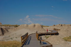 Boardwalk in Badlands National Park, South Dakota. This is a short curvy boardwalk in Badlands National Park in South Dakota. One little boy stood gazing at the Royalty Free Stock Photos