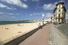 A boardwalk on the beach of St. Jean de Luz, on the Cote Basque, South West France, a typical fishing village in the French-Basque Royalty Free Stock Images