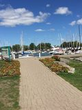 The boardwalk to the sailboats. Lakefront walkway towards the Stock Photos