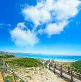 Boardwalk in Capo Testa under a cloudy sky Stock Photos