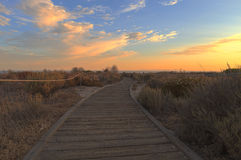 Boardwalk at Crystal Cove beach at sunset Stock Images