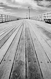 Boardwalk Of Distance. Emptiness Fills My Steps, While Vertical Lines Of Solitude Stretch The Void, On The Boardwalk Of Distance Royalty Free Stock Photos
