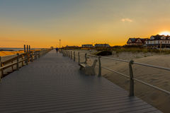Boardwalk at Dusk in Autumn. Photo of a boardwalk at the Jersey Shore in mid-Autumn, late in the afternoon as the sun begins to set Royalty Free Stock Photography