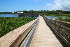 Boardwalk Green Cay Wetlands. A boardwalk with metal guard rails leads to the rest area at Green Cay Wetlands Nature Preserve, Boynton Beach, Florida stock image