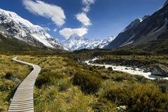 Boardwalk in the Hooker valley looking towards Mt Cook Stock Images