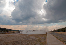 Boardwalk between Hot Lake hot spring and Firehole Lake drive in the Lower Geyser Basin in Yellowstone National Park in Wyoming US Royalty Free Stock Photo
