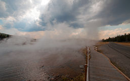 Boardwalk between Hot Lake hot spring and Firehole Lake drive in the Lower Geyser Basin in Yellowstone National Park in Wyoming US Royalty Free Stock Images
