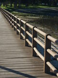 Boardwalk By The Lake. A boardwalk along a lake with low water Royalty Free Stock Photo