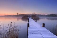 Boardwalk on a lake at dawn in winter, The Netherlands Stock Photo