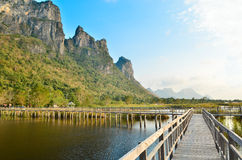 Boardwalk on the lake with mountain in national park Stock Images