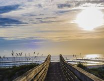Boardwalk at late morning seaside. stock photos