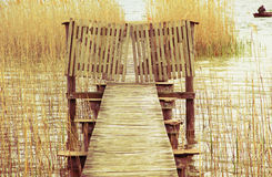 Boardwalk and lattice door, fisherman, tranquil scenery Royalty Free Stock Photography