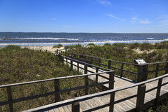 Boardwalk Leading to the Beach. Caswell Beach in North Carolina during the Summer royalty free stock images